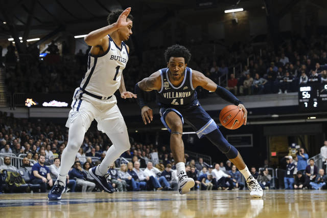 Villanova forward Saddiq Bey (41) dribbles the ball in front of Butler forward Jordan Tucker (1) during the second half of an NCAA college basketball game in Indianapolis, Wednesday, Feb. 5, 2020. Butler won 79-76. (AP Photo/AJ Mast)