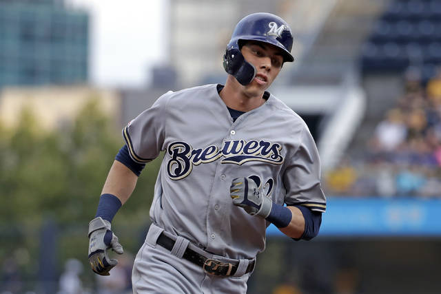 FILE - In this Monday, Aug. 5, 2019 file photo, Milwaukee Brewers' Christian Yelich rounds third after hitting a solo home run off Pittsburgh Pirates starting pitcher Dario Agrazal during the first inning of a baseball game in Pittsburgh. The Milwaukee Brewers have a lot of work to do in spring training. Having Christian Yelich sure helps. Yelich was working on a strong case for his second straight NL MVP award last year when he broke his right kneecap in September, sidelining the All-Star slugger for the rest of the season. (AP Photo/Gene J. Puskar, File)