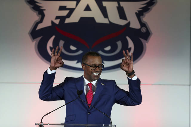 FILE- In this Dec. 12, 2019, file photo, former Florida State coach Willie Taggart is introduced as Florida Atlantic University's new football head coach during a press conference in Boca Raton, Fla. Colleges around the country finished off their football signing classes this week, proudly touting scores of African-American athletes as their next big stars. A review of all 130 FBS schools found shockingly low numbers, with blacks still largely shut out of head coaching positions and even more so the prime coordinator spots.    (Carline Jean/South Florida Sun-Sentinel via AP)