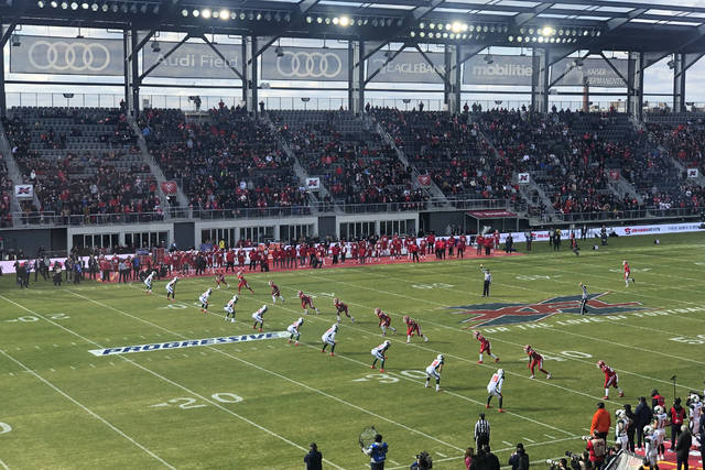 The D.C. Defenders, right, line up against the Seattle Dragons for the opening kickoff of the opening football game of the XFL season, Saturday, Feb. 8, 2020, in Washington, DC. (AP Photo/Stephen Whyno)