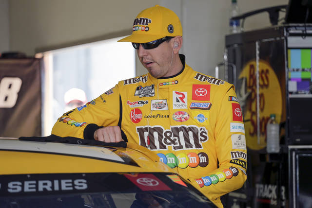Kyle Busch prepares to get in his car during NASCAR auto race practice at Daytona International Speedway, Saturday, Feb. 8, 2020, in Daytona Beach, Fla. (AP Photo/Terry Renna)