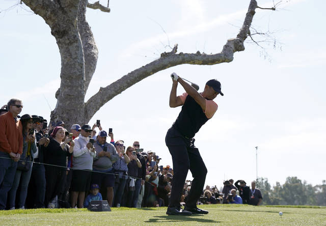 Tiger Woods tees off on the third hole during the first round of the Genesis Invitational golf tournament at Riviera Country Club, Thursday, Feb. 13, 2020, in the Pacific Palisades area of Los Angeles. (AP Photo/Ryan Kang)