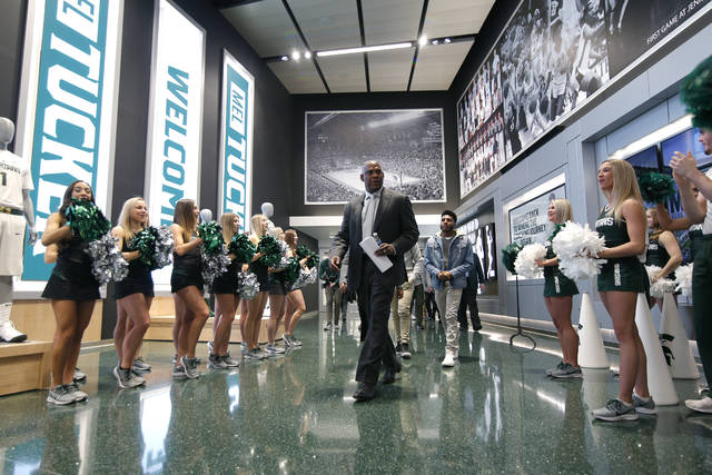 Mel Tucker, Michigan State's new football coach, enters a news conference Wednesday, Feb. 12, 2020, in East Lansing, Mich. (AP Photo/Al Goldis)