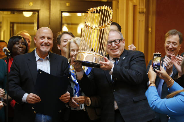Del. Mark Sickles, D-Fairfax., right, holds the Washington Nationals World Series trophy as Nationals president and General Manager, Mike Rizzo, left, looks on as the Virginia House of Delegates honors the team during the session at the Capitol Tuesday Jan 28, 2020, in Richmond, Va. (AP Photo/Steve Helber)