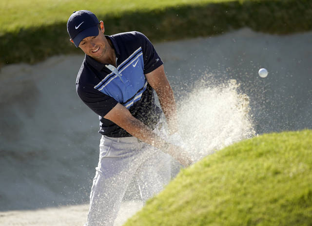 Rory McIlroy, of Northern Ireland, hits out of a bunker onto the 17th green during the final round of the Genesis Invitational golf tournament at Riviera Country Club, Sunday, Feb. 16, 2020, in the Pacific Palisades area of Los Angeles. (AP Photo/Ryan Kang)