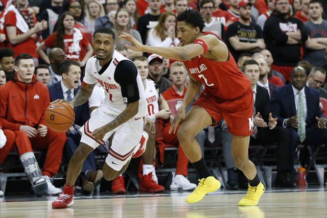 Ohio State's Luther Muhammad, left, brings the ball upcourt past Maryland's Aaron Wiggins during the second half of an NCAA college basketball game Sunday, Feb. 23, 2020, in Columbus, Ohio. (AP Photo/Jay LaPrete)