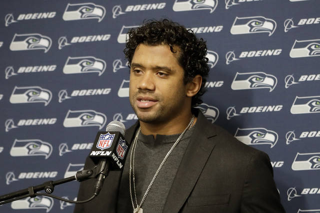 FILE - In this Dec. 8, 2019, file photo, Seattle Seahawks quarterback Russell Wilson speaks during a news conference after an NFL football game against the Los Angeles Rams in Los Angeles. Ratification of a new collective bargaining agreement between the NFL and its players is an important step closer after a narrow majority approval by team union representatives, but there's still work to be done to ensure another decade of labor peace. Wilson is one of the players who have spoken out against the current proposal.(AP Photo/Marcio Jose Sanchez, File)
