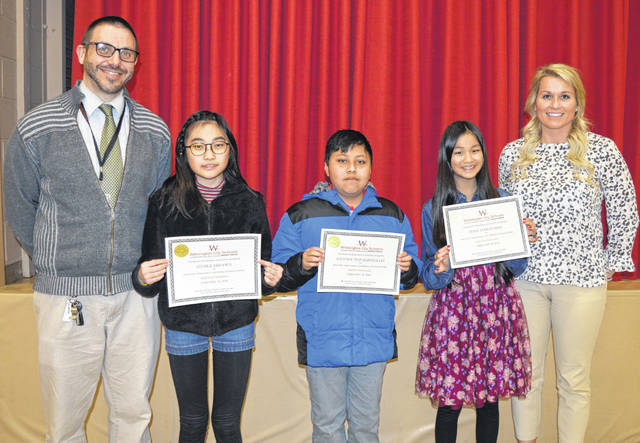 """At a school board meeting, three East End Elementary fifth-graders were recognized for being """"determined not to let the language barrier hold them back."""" From left are fifth-grade teacher Andrew Lefevre, students Ichika Ebisawa, Antony Puz Siquinajay and Hina Maruyama, and Principal Jen Martin. Lefevre said he understands some of the challenges of being a student trying to do well where the language used is not your first language — he was a Rotary exchange student in Brazil."""