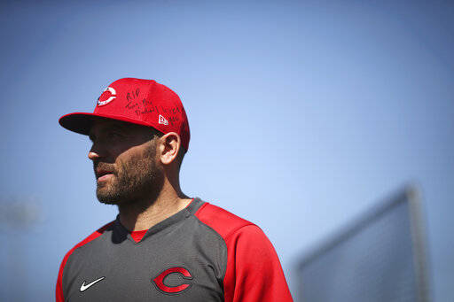 Cincinnati Reds first baseman Joey Votto has a message on his hat in honor of Tony Fernandez, who died recently, during baseball spring training Wednesday, Feb. 19, 2020, in Goodyear, Ariz. (Kareem Elgazzar/The Cincinnati Enquirer via AP)