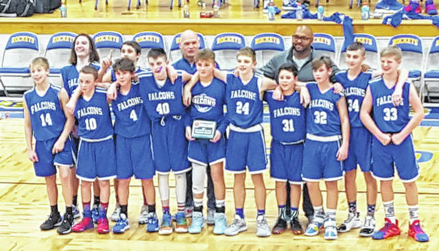 The Clinton-Massie seventh grade boys basketball team won the SBAAC championship tournament with a win over Goshen in the title game. The young Falcons also defeated a team from Western Brown and Wilmington in the tournament. In the photo, from left to right, Cooper Carmichael, Peyton Brewer, Jason Flint, Ty Clutter, Carson McDowell, Ashton Carpenter, Brady Russell, Cale Wilson, Avden Faucett, Liam Eades, CJ Greene, Brendan Musser; back row, coaches Dominique Smith and Fred Carmack.