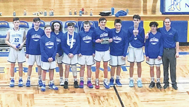 The Clinton-Massie eighth grade boys basketball team won the SBAAC tournament championship. The young Falcons defeated a team from Western Brown in the championship following a win over Blanchester. In the photo, from left to right, Liam Denehy, Elias Scott, Nathan Voisey, Miles Theetge, Brighton Rodman, Ryan Dillon, Drew Robinson, Brandon Moritz, Sawyer Conrad, Cale Migal, coach Tyler Uetrecht. Team member Jerry Trout was not present for the photo.