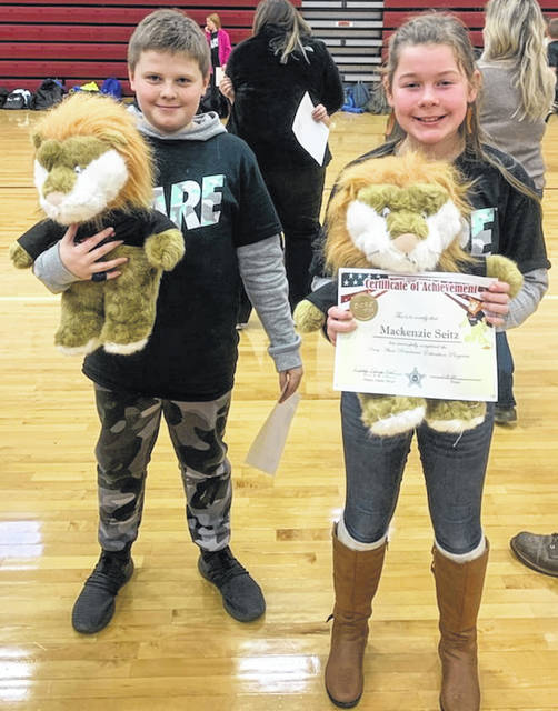 Essay contest second-place winners of Daren the Lion are Jackson Strouth and Mackenzie Seitz.
