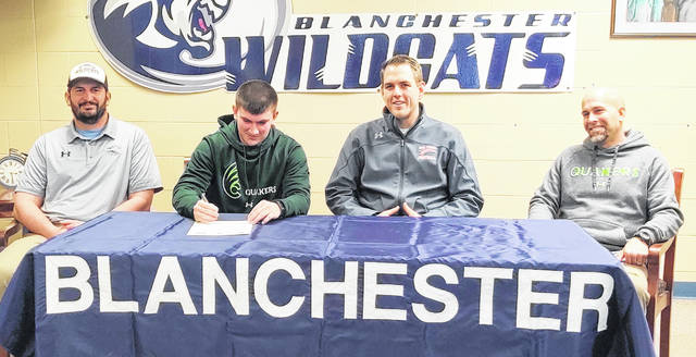 Blanchester High School senior Jasper Damewood has chosen to continue his athletic and academic career at Wilmington College. Damewood is a kicker for the Blanchester football team. In the photo, from left to right, BHS head football coach Jon Mulvihill, Jasper Damewood, coach Tyler Warner of Kornblue Kicking and Brian Damewood.