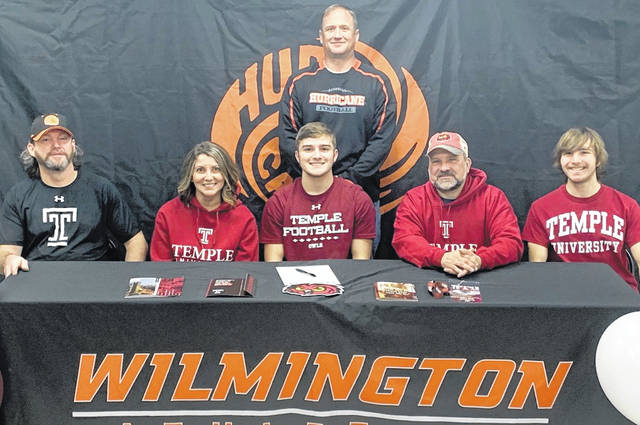 Rory Bell will attend Temple University and play football next year and signed his letter on Wednesday. In the photo from left to right, front row, Rob Weinel, Tammy Weinel, Rory Bell, Shawn Bell, Brendan Bell; back row, WHS football coach Scott Killen.