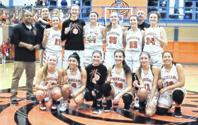 The Wilmington High School girls basketball program won its third straight SBAAC American Division basketball championship Monday with a win over Goshen. The Hurricane finished 9-1 in the division and shared top honors with Western Brown. In the photo, from left to right, front row, Sophie Huffman, Jasmine Jamiel, Zoey Moore, Sami McCord, Taylor Noszka, Keasia Robinson; middle row, coach Jermaine Isaac, Caroline Diels, Maura Drake, Karlie Morgan, Katie Murphy, Sydney McCord, Aeris McDaniel; back row, head coach Zach Williams, Josephine Williams, coach Dusty James.