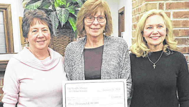 Cindy Petrich (left) and Kathy Havey (right), representatives from the Health Alliance Clinton County, present Patti Settlemyre (center), retired executive director and founder of Community Care Hospice, with a $3,000 donation for patient care.