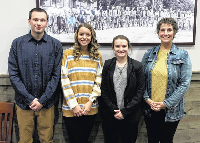 The Wilmington Rotary Club which meets at noon on Mondays at the Park Vue Restaurant honored as Students of the Month Kathryn Hardin of Wilmington High School, Savannah Henderson of Clinton-Massie High School and Matthew Moskal of East Clinton High School. From left are Moskal, Hardin, Henderson and Rotary President Katherine Harrison-Tigar