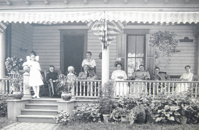 "This undated photo was taken on the southeast corner of Columbus and Lincoln streets in Wilmington of, from left, ""Elizabeth Denver Johns, Grandma Harriet Emily (Byard) Brown, Aunt Jennie Jane Campbell Johns, Dad Samuel Johns II, Mama Winnie May (Brown) Johns, Susie Nickerson Hadley, Gene Hadley, 'Aunt Winnie' - really 1st cousin - wife of Gene Hadley."" Can you tell us more? Share it at info@wnewsj.com. The photo is courtesy of the Clinton County Historical Society. Like this image? Reproduction copies of this photo are available by calling the History Center. For more info, visit www.clintoncountyhistory.org; follow them on Facebook @ClintonCountyHistory; or call 937-382-4684."