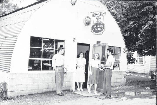 Students gather outside the Quonset hut known as The Cove, a snack bar/student union in the immediate post-World War II era.