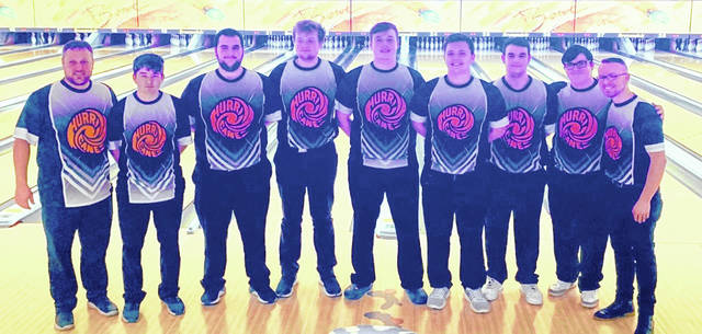 The Wilmington High School boys bowling team, from left to right, coach Joe Gigandet, Hunter Gallion, Elijah Martini, Grant Pickard, Jordan Macik, Jordan Tackett, Isaac Martini, Hunter Wright and head coach Dustin Brown.