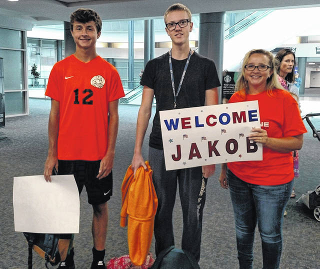 Jakob Lindeselt from Sweden, middle, gets a warm welcome to America.