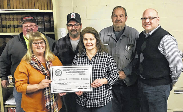 The Jefferson Township Trustees have begun making plans to host two community cleanup events in 2020 — the first in April and the second in August. The Solid Waste Management District will be partnering with the township by providing financial assistance through its 2020 Community Grant program. Pictured are County Commissioner Brenda Woods and District Coordinator Jeff Walls presenting a check to the Jefferson Township officials in support of their cleanup programs.