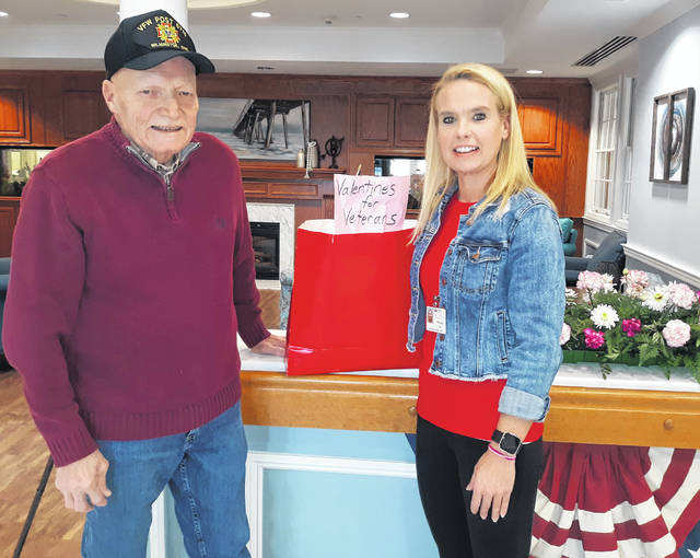 Melissa Ladd of the Ohio veterans Home receives approximately 170 cards from local veteran Paul Butler.