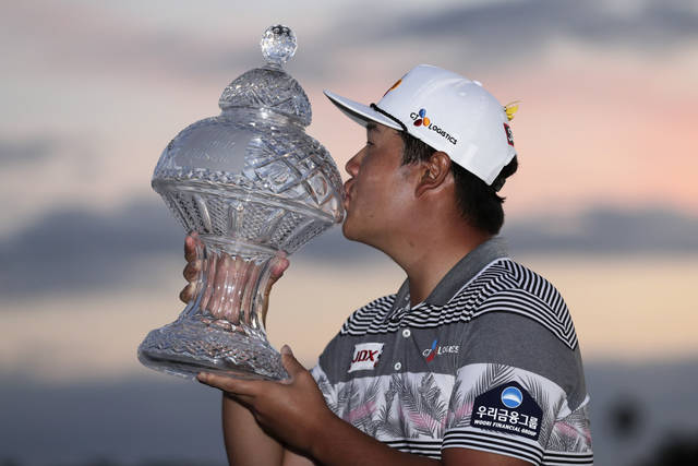 Sungjae Im of South Korea kisses the trophy after winning the Honda Classic golf tournament, Sunday, March 1, 2020, in Palm Beach Gardens, Fla. (AP Photo/Lynne Sladky)
