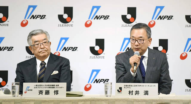 Japan Pro-Baseball Commissioner Atsushi Saito, left, and J-League Chairman Mitsuru Murai attend a press conference at a hotel in Tokyo Monday, March 2, 2020. The opening of Japanese professional baseball's regular season is in doubt over the outbreak of the new virus, they said Monday, as the nation's baseball and soccer leagues tapped three medical experts as advisers. (Ren Onuma/Kyodo News via AP)