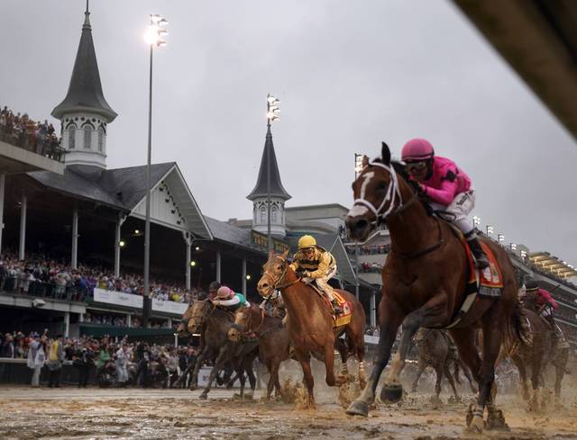 FILE - In this May 4, 2019, file photo, Luis Saez rides Maximum Security, right, across the finish line first against Flavien Prat on Country House during the 145th running of the Kentucky Derby horse race at Churchill Downs in Louisville, Ky. Citing unidentified sources close to the race, the Courier-Journal of Louisville said Churchill Downs will postpone the Derby from May 2, 2020, to Sept. 5, making it the first time in 75 years that the race won't be run on the first Saturday in May. (AP Photo/Matt Slocum, File)