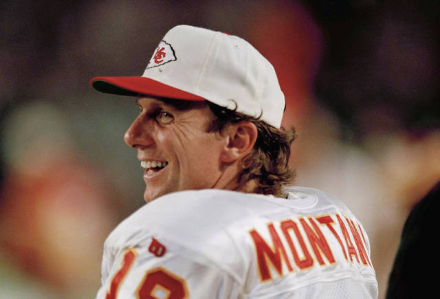 FILE - In this Dec. 12, 1994 file photo Kansas City Chief's quarterback Joe Montana watches from the sidelines during an NFL football game against the Miami Dolphins. Tom Brady's departure from the New England Patriots on Tuesday, March 17, 2020 brings an end to one of the NFL's most memorable eras. Joe Montana was in some ways a previous generation's version of Brady — an iconic quarterback who was calm under pressure and always seemed to have his team in contention for a championship. He won four Super Bowl titles with San Francisco, but after elbow problems limited him for a couple seasons, the 49ers traded Montana to Kansas City. The Chiefs had Montana for two seasons and reached the AFC title game with him once. (AP Photo/Han Deryk, file)