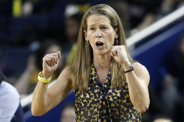 FILE - In this Jan. 5, 2020, file photo, Michigan head coach Kim Barnes Arico directs her team during the second half of an NCAA college basketball game against Michigan State in Ann Arbor, Mich. The outbreak of the coronavirus brought the sports world — the whole world, really — to a screeching halt, and that includes the crucial recruiting period for college coaches that were putting the finishing touches on their 2020 classes while laying the all-important groundwork for next year's classes. (AP Photo/Carlos Osorio, File)