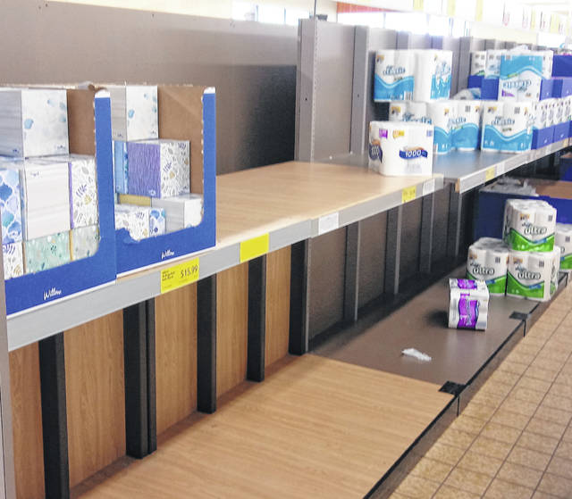 The toilet paper shelves were empty at the Wilmington Aldi Friday morning.