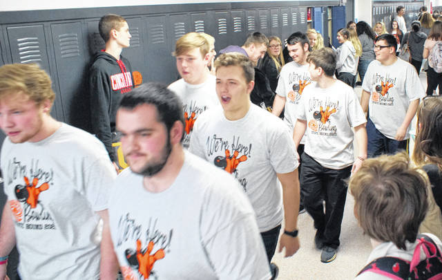 Wilmington High School bowlers Grant Pickard, Elijah Martini, Jordan Macik, Jordan Tackett, Isaac Martini, Hunter Gallion and Hunter Wright during their sendoff Wednesday afternoon through the halls of WHS.