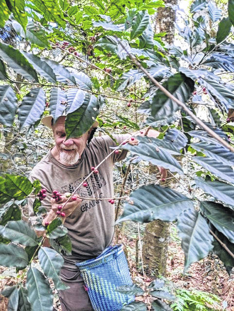 Clinton County farmer Jon Branstrator, picking coffee beans in Mexico this past January, will be the featured speaker April 21.