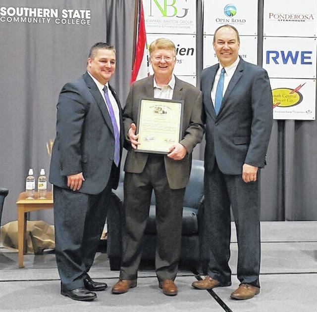 With SSCC President Dr. Kevin Boys are State Rep. Shane Wilkin, left, and State Senator Bob Peterson, right.