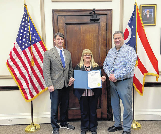 Clinton County Commissioners, from left, Kerry Steed, Brenda Woods and Mike McCarty with the resolution honoring the late Chester Wilson. The resolution commemorating the long, distinguished life of service of Chester Wilson.
