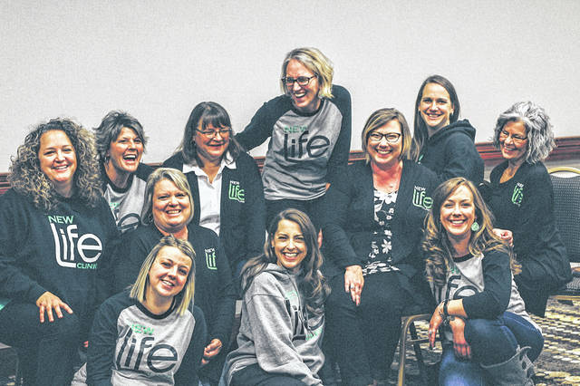 Shown are: front row, Stephanie Maher, Missy Holmes (directly above Stephanie), Karen Anderson, and Courtney Hoak; and, back row, Cheryl Brackemyre, Dee Moore, Diane Hertlein, Sherry Weller (standing), Karla Barker, Laura Myers and Shelia Bracht.