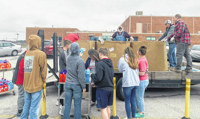 Volunteers work to ensure that students in the Blanchester area get a good lunch.