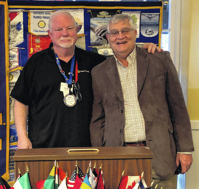 Dr. Randy Overbeck, right, with Wilmington AM Rotary president Brad Reynolds.