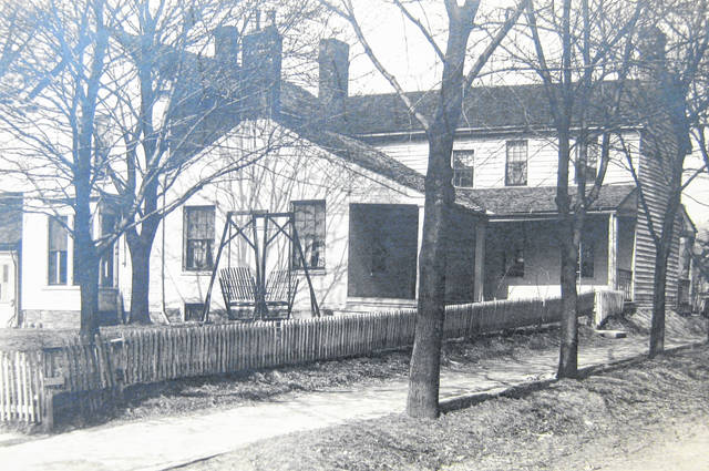 """This photo states that it is of the """"States home"""" in Wilmington, taken sometime in the early 1900s """"where the jail now stands"""" (presumably in downtown Wilmington). Can you tell us more? Share it at info@wnewsj.com. The photo is courtesy of the Clinton County Historical Society. Like this image? Reproduction copies of this photo are available by calling the History Center. For more info, visit www.clintoncountyhistory.org; follow them on Facebook @ClintonCountyHistory; or call 937-382-4684."""