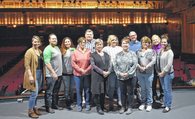 The Rock the Block crew, from left: Chamber of Commerce Executive Director Dessie Rogers, Jason and Michelle Vaughn of Tin Cap, Murphy Theatre Coordinator Jean Black, Murphy Theatre Tech Director Joe Spicer, Murphy Theatre Executive Director Maretta Alden, CVB Executive Director Susan Valentine-Scott and Executive Assistant Melissa Hedrick, Murphy Theatre Marketing Director Andrew Conarroe, Kathleen Norman of the Murphy Theatre, Murphy's Development Director Joni Streber, and Wilmington City Administrator Marian Miller. Not pictured are Wilmington Police Sgt. Ron Fithen, Dan Gray with 1Dog Entertainment, Wilmington Streets Superintendent Jerry Runk, Taylor Stuckert of the Regional Planning Committee, and Mark Elliot of The Escape.