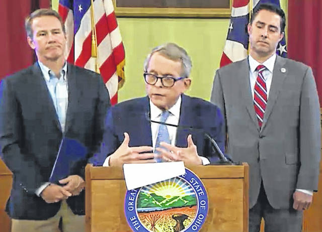 Ohio Gov. Mike DeWine flanked by state officials at Monday's press conference.