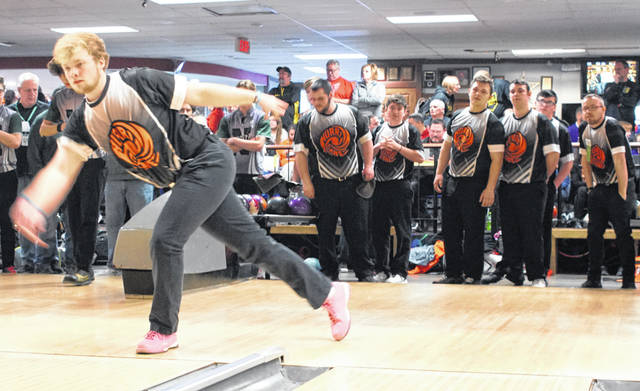 Wilmington High School senior Grant Pickard (left) bowls at the Division I OHSAA Boys Bowling Championship tournament Friday at Wayne Webb's Columbus Bowl as his teammates and coaches look on. The News Journal will keep you updated with final team and individual standings.