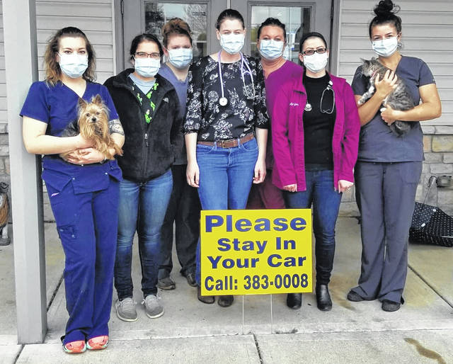 "From left at Orchard Veterinary Care are Becca Boggs, Kate Justice, Makayla Dean, Dr. Allison Bittner, Shelly Gilbert, Dr. Jackie Gano, and Paige Burton. The staff is practicing social distancing and is also donating some of their PPE equipment to their ""human healthcare compatriots."""