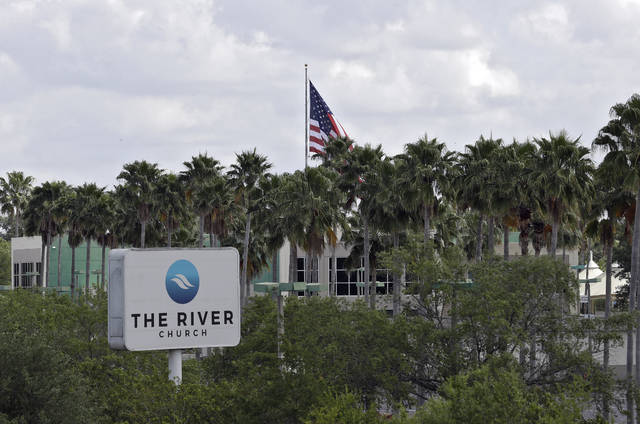 The River Church is shown Monday, March 30, 2020, in Tampa, Fla. The Hillsborough County Sheriff's Office has warned the megachurch about violating a safer-at-home order in place to limit the spread of coronavirus. The church is continuing to hold Sunday church services despite warnings for social distancing in order. (AP Photo/Chris O'Meara)