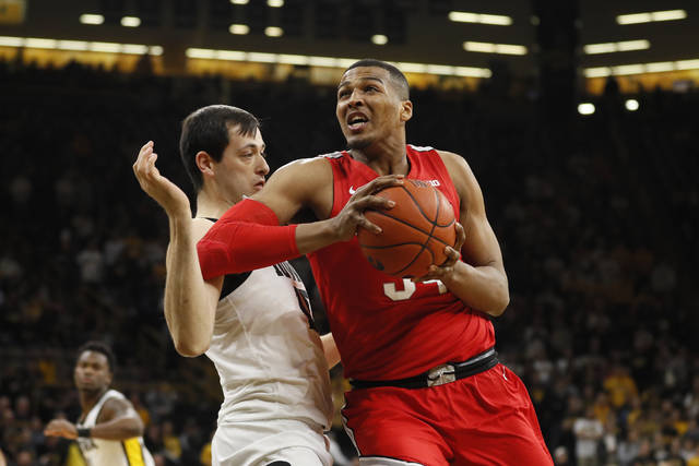 FILE - In this Feb. 20, 2020, file photo, Ohio State forward Kaleb Wesson drives against Iowa forward Ryan Kriener during the first half of an NCAA college basketball game in Iowa City, Iowa. Wesson announced in a Wednesday night, April 1, 2020, tweet that he would forego his final year of eligibility and declare for the NBA draft. Analysts have projected him as a second-round pick. (AP Photo/Charlie Neibergall, File)