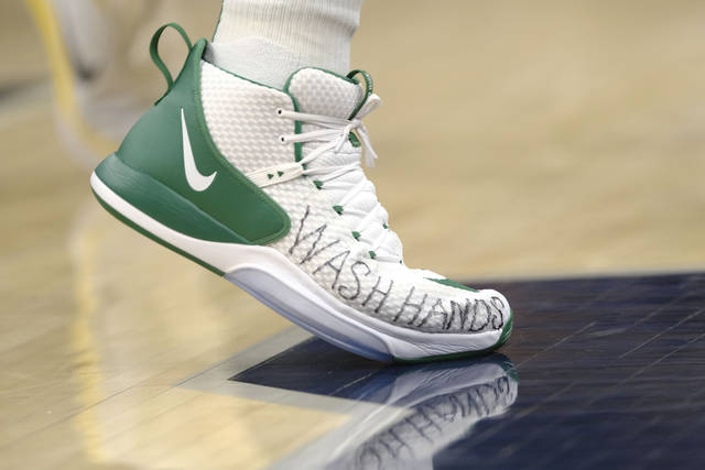 "Boston Celtics center Enes Kanter wears shoes with ""wash hands"" written on them during the second half of the team's NBA basketball game against the Indiana Pacers in Indianapolis, Tuesday, March 10, 2020. The Celtics won 114-111. (AP Photo/AJ Mast)"