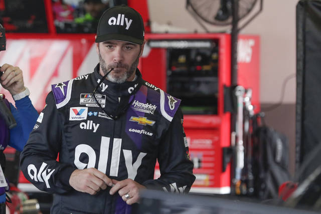 FILE - In this Feb. 15, 2020, file photo, Jimmie Johnson gets ready for a practice session for the NASCAR Daytona 500 auto race at Daytona International Speedway in Daytona Beach, Fla. Jimmie Johnson wanted to retire from full-time racing to step away from NASCAR's 11-month grind. The coronavirus pandemic has brought his final season to an unexpected pause, and now the seven-time champion isn't sure what his future holds.(AP Photo/John Raoux, File)