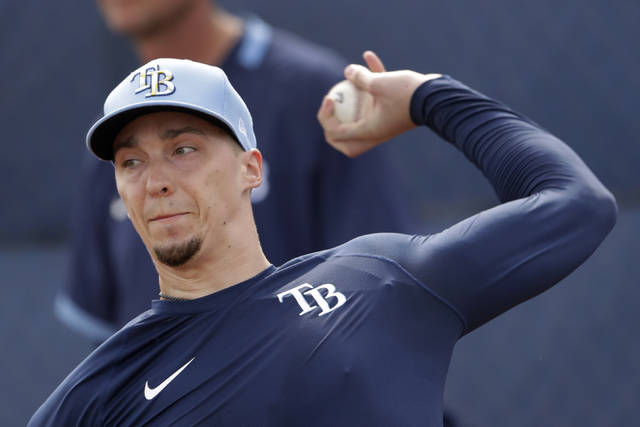 Tampa Bay Rays starting pitcher Blake Snell throws during spring training baseball camp Friday, Feb. 14, 2020, in Port Charlotte, Fla. (AP Photo/John Bazemore)